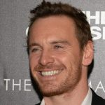 a picture of Michael Fassbender smiling at a premiere of his film