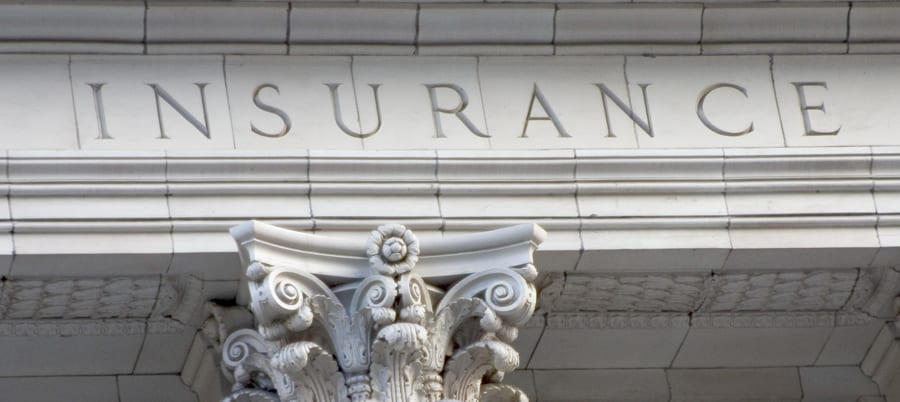 landlords building insurance image with insurance on the side of a building