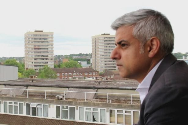 London Mayor standing on the balcony of a housing estate