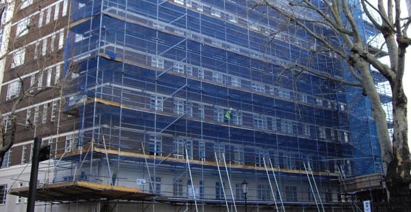 block management company in london putting scaffolding up